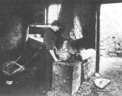 Photo of a woman working at a hearth - from Roy Palmer's postcard collection.